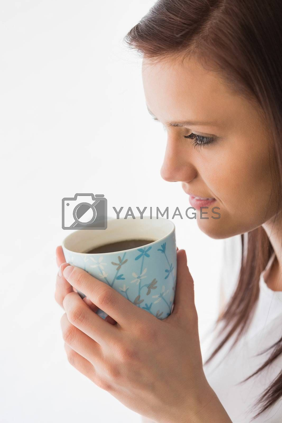 Thoughtful girl drinking a cup of coffee by Wavebreakmedia
