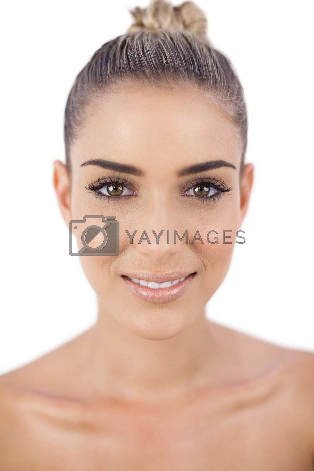 Delighted woman looking at camera by Wavebreakmedia