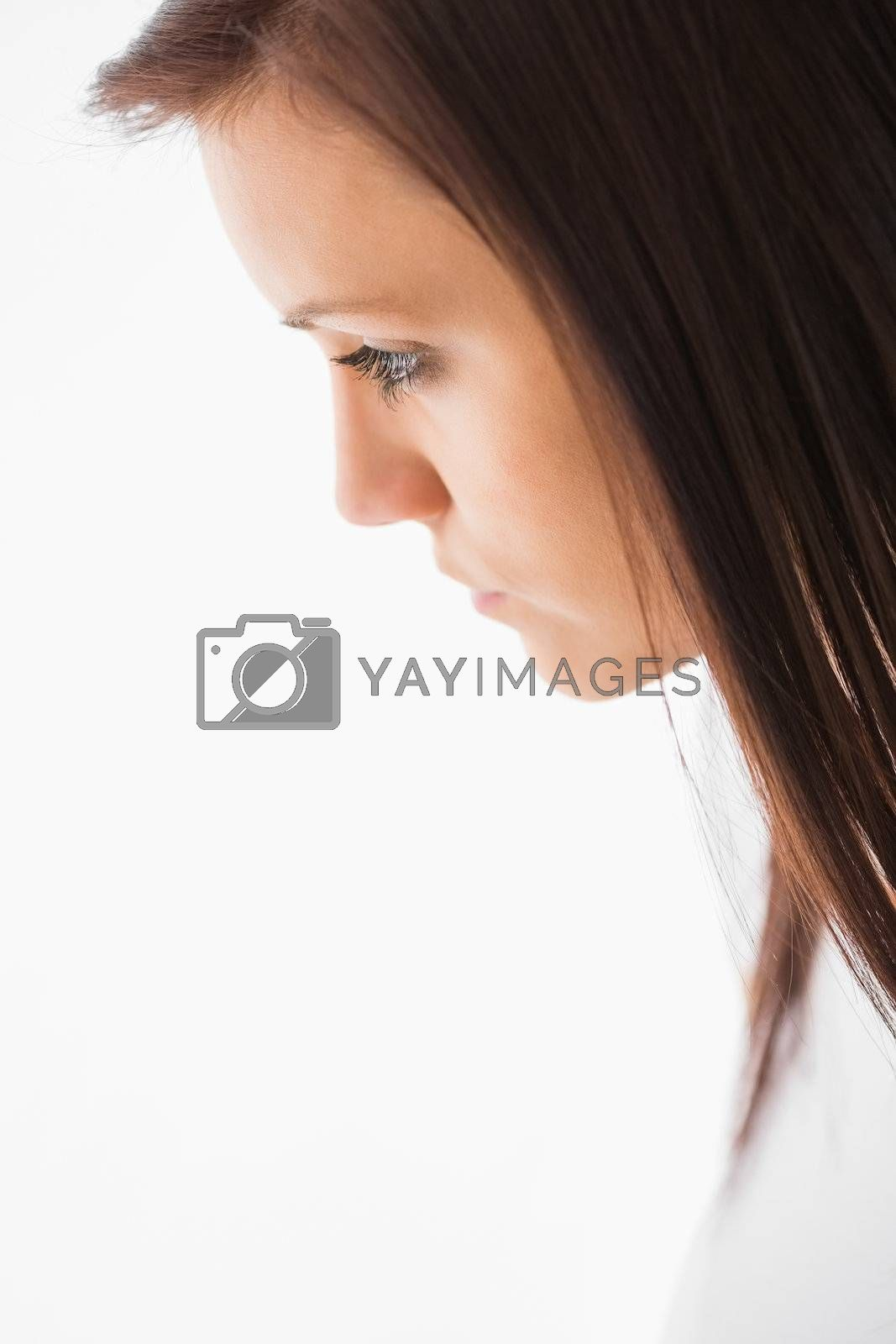 Thoughtful girl looking away by Wavebreakmedia