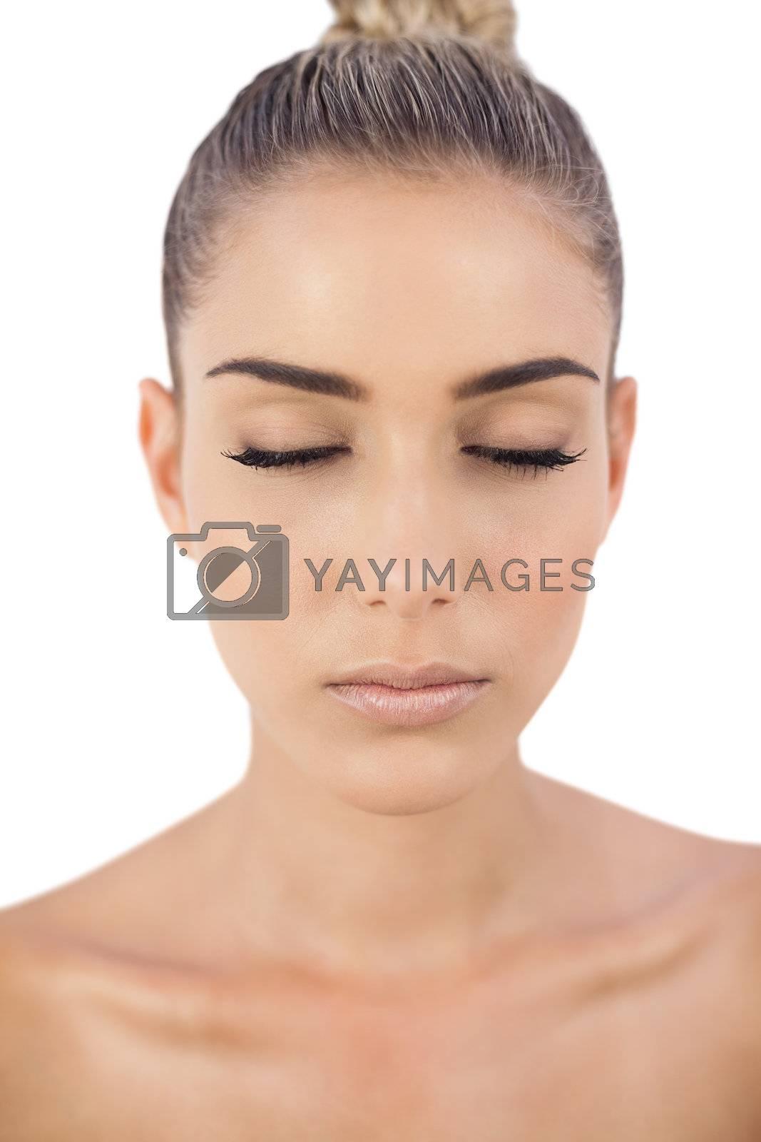 Serious woman closing her eyes by Wavebreakmedia