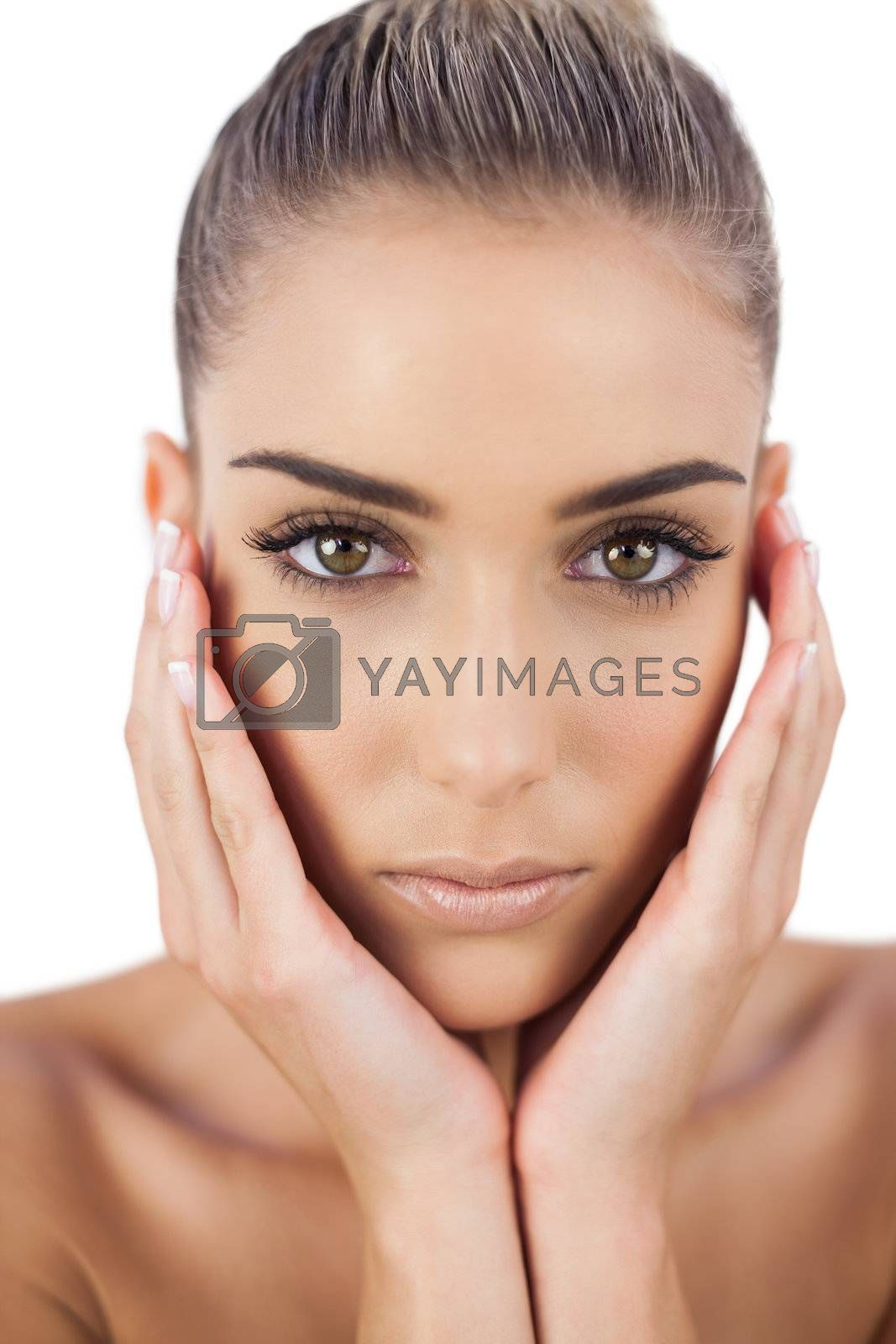 Beautiful woman holding her head and looking  by Wavebreakmedia