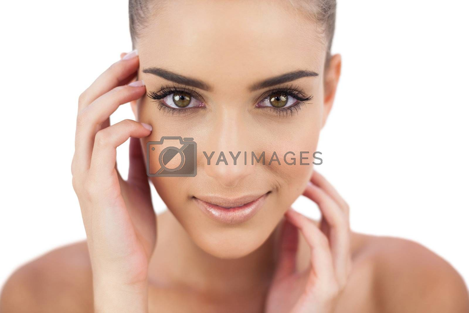 Close up of a smiling woman looking at camera by Wavebreakmedia