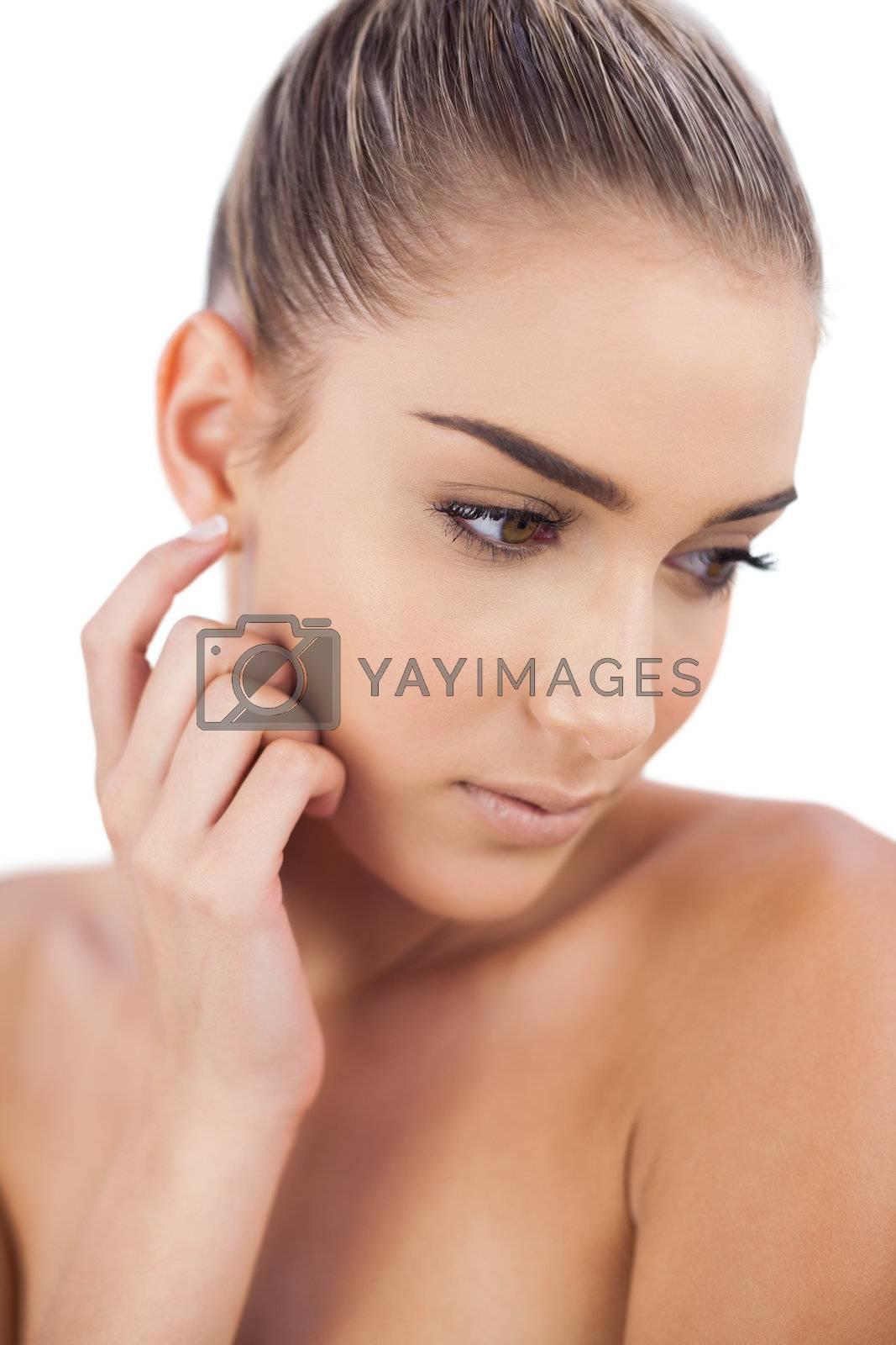 Dreamy woman looking away by Wavebreakmedia