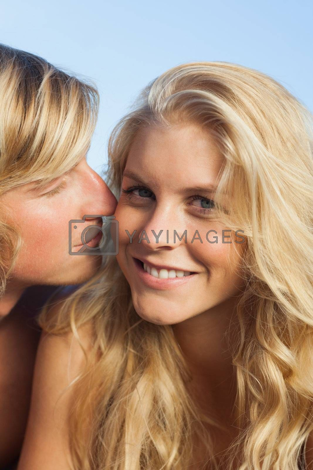 Close up view of man giving kiss to woman by Wavebreakmedia
