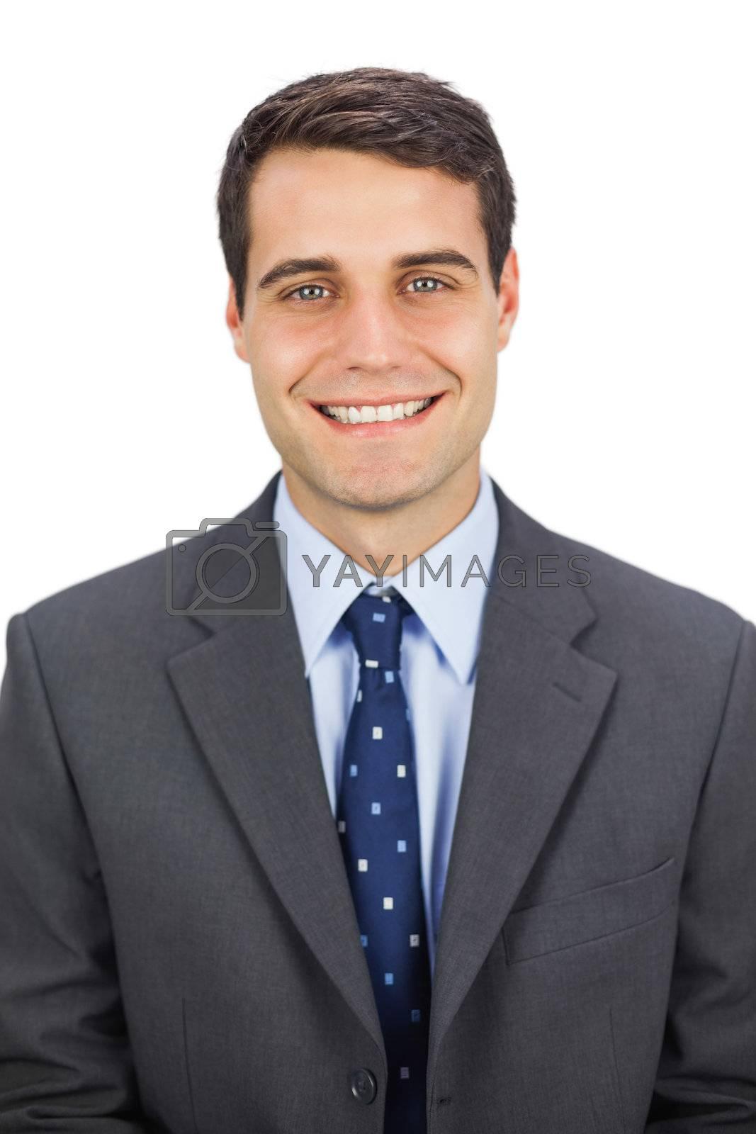 Smiling businessman looking  by Wavebreakmedia