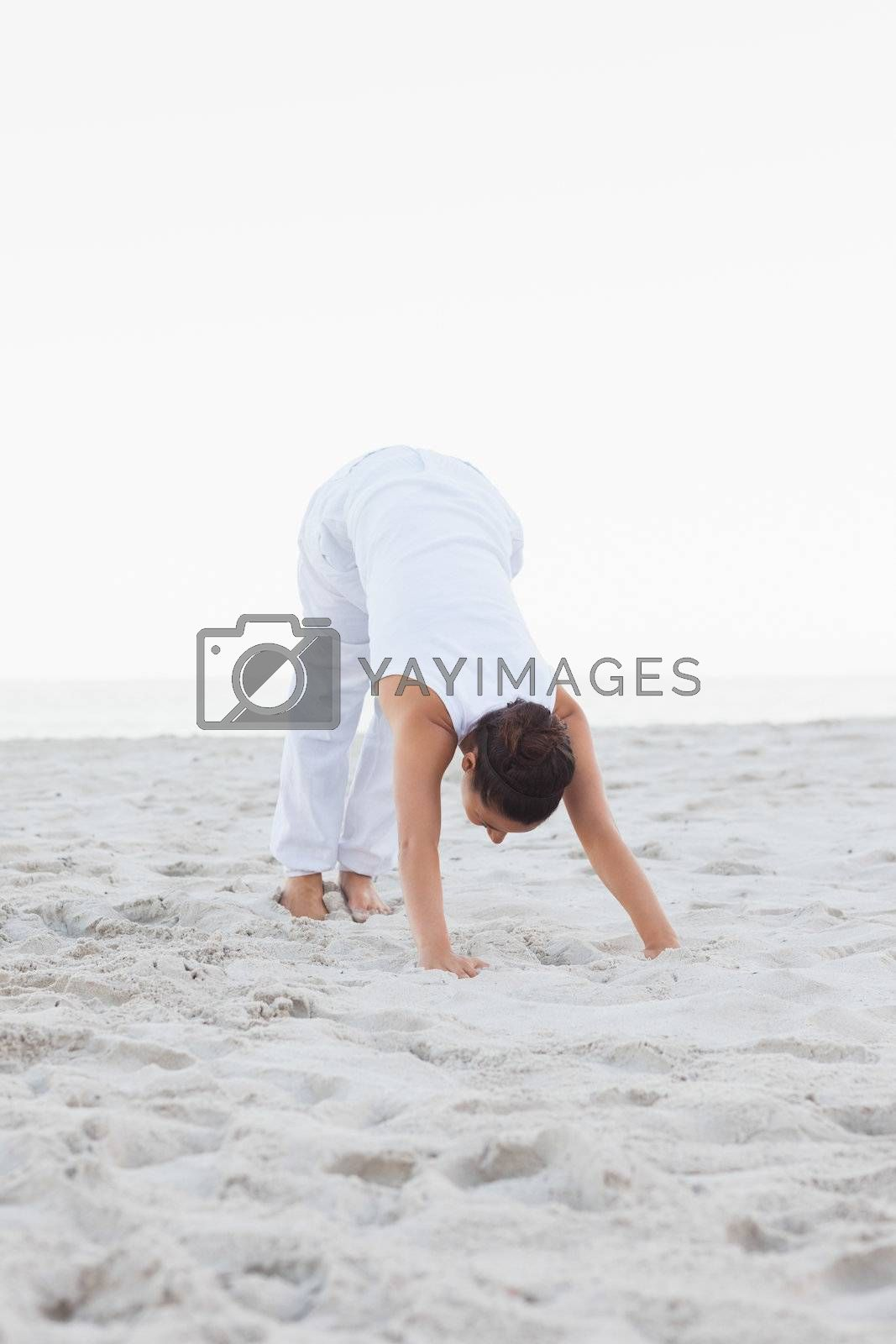 Woman in extended triangle yoga pose by Wavebreakmedia