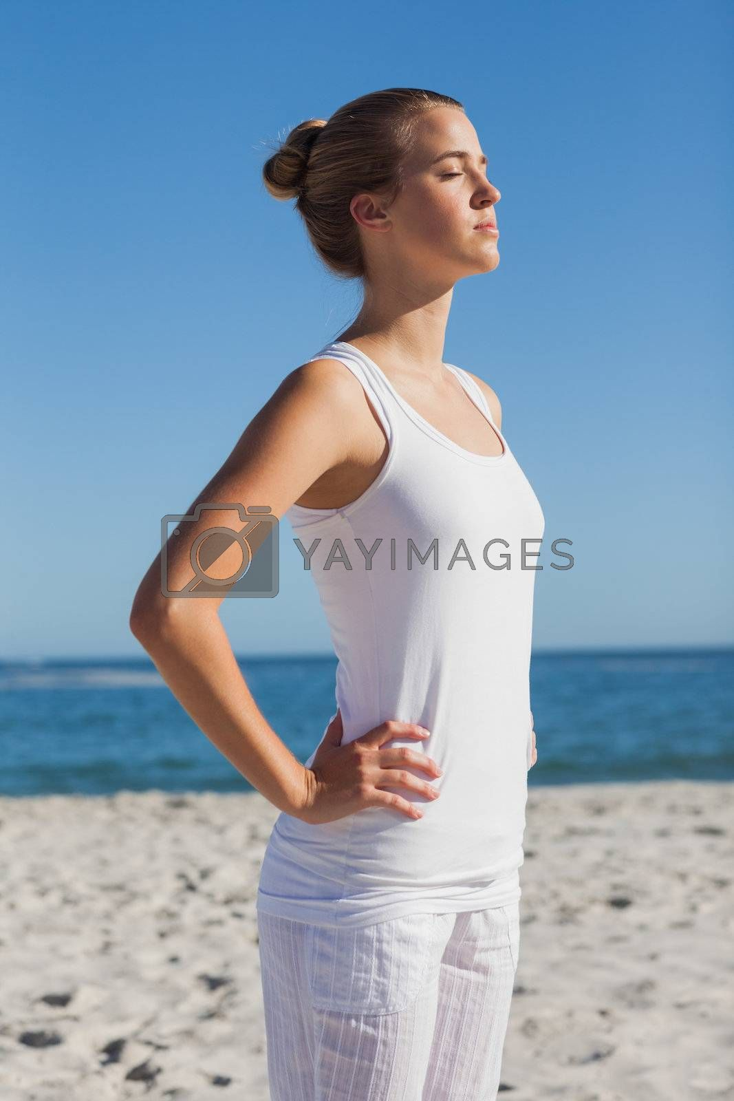 Attractive woman standing and relaxing  by Wavebreakmedia
