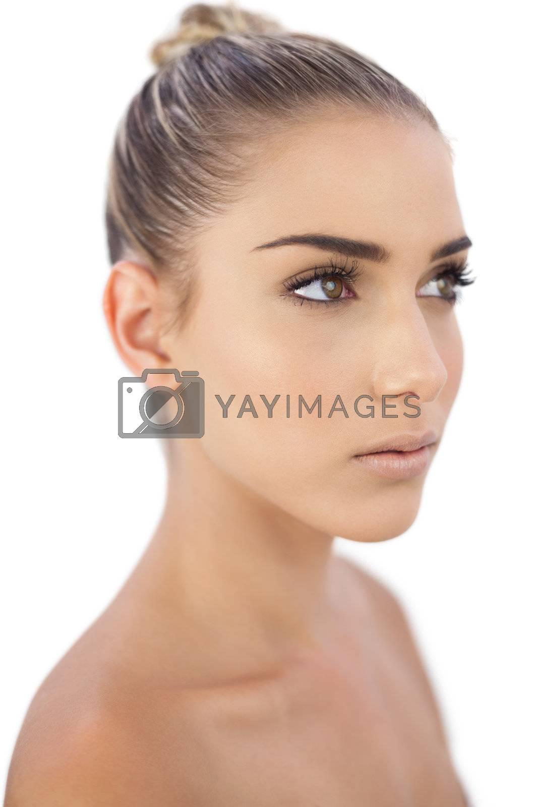 Thoughtful woman looking away by Wavebreakmedia