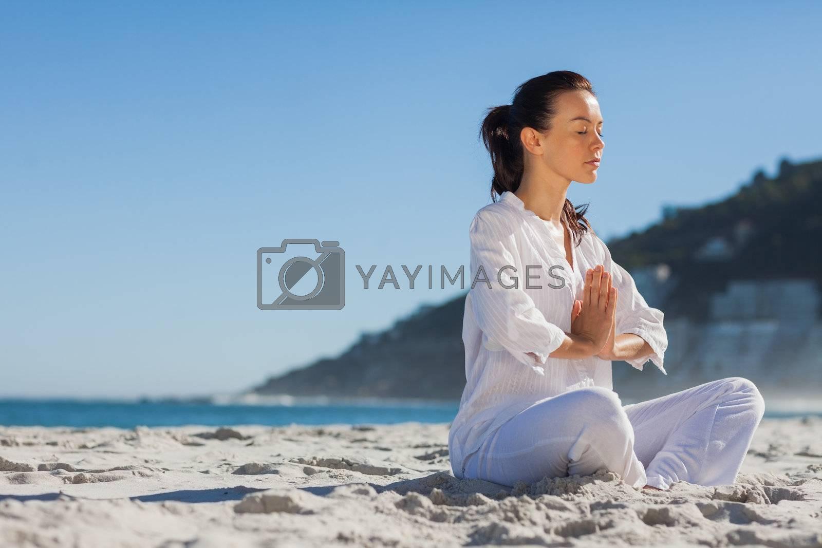 Calm woman practicing yoga  by Wavebreakmedia