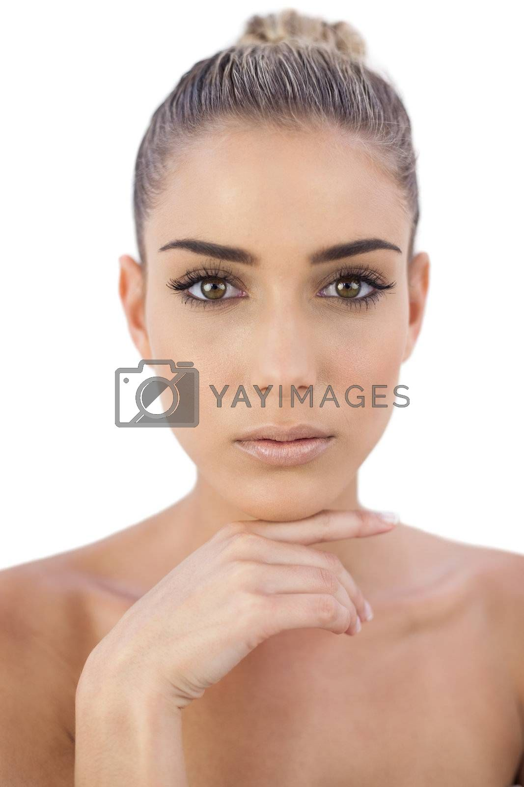 Concentrated woman looking at camera by Wavebreakmedia