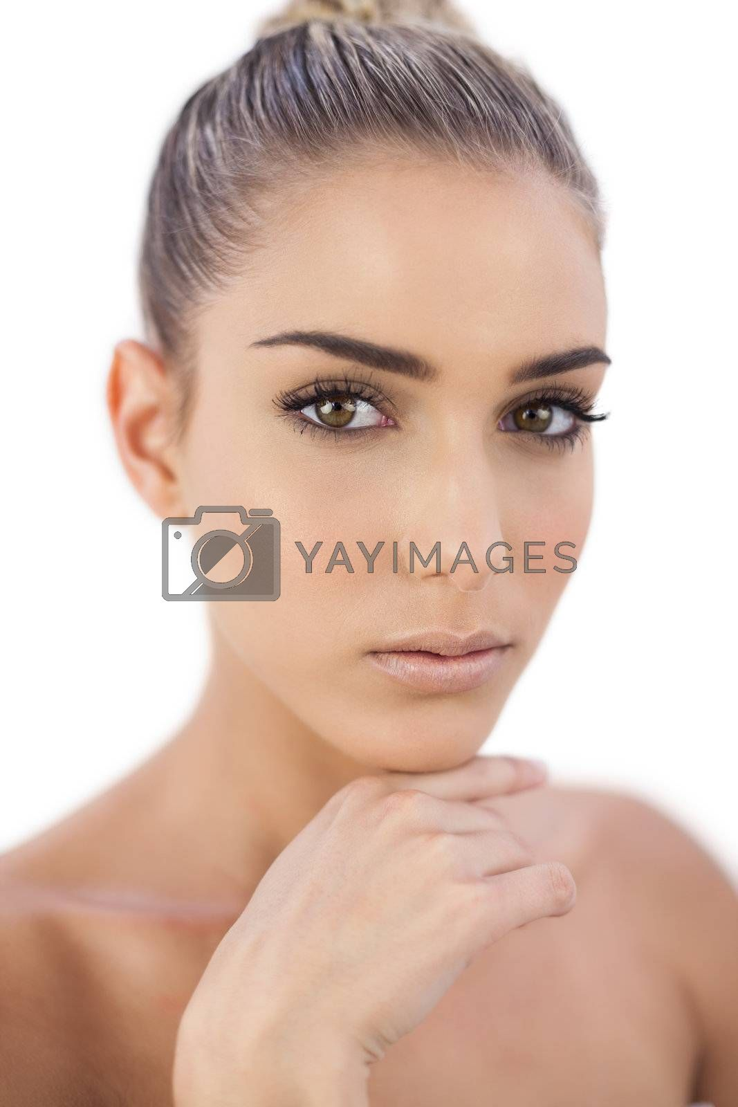 Thinking woman looking at camera by Wavebreakmedia