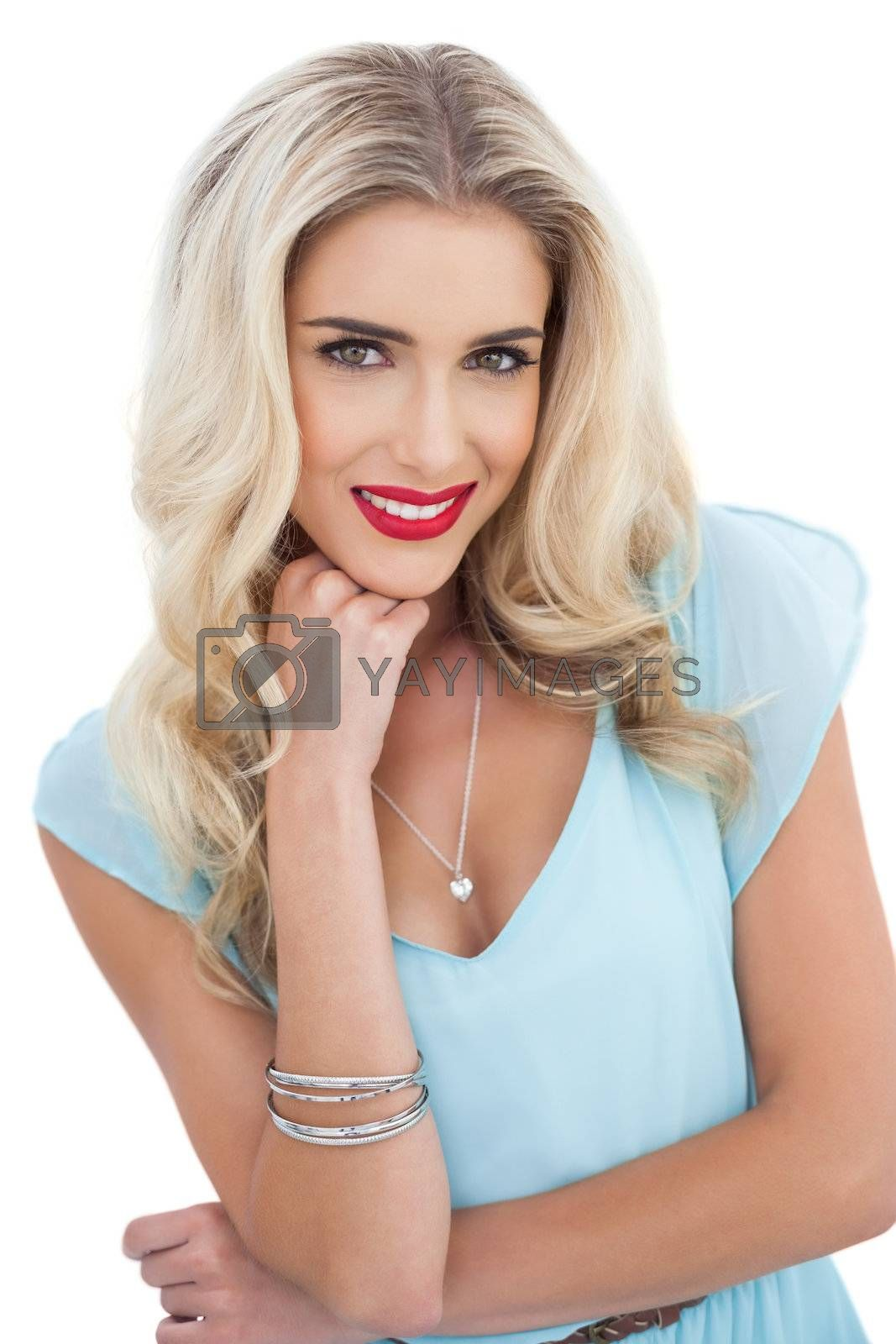 Attractive blonde model in blue dress looking  by Wavebreakmedia