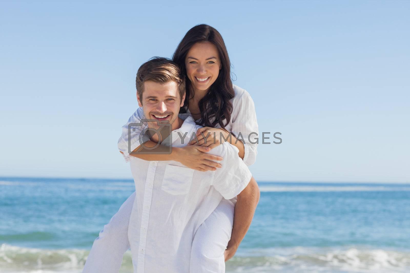 Happy couple smiling at camera by Wavebreakmedia