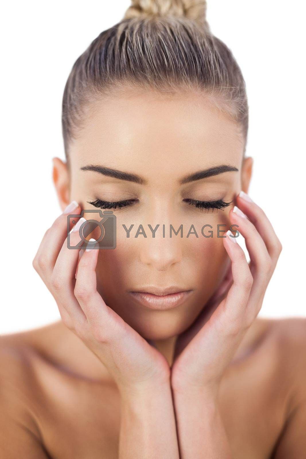 Concentrated woman holding her head and closing her eyes by Wavebreakmedia