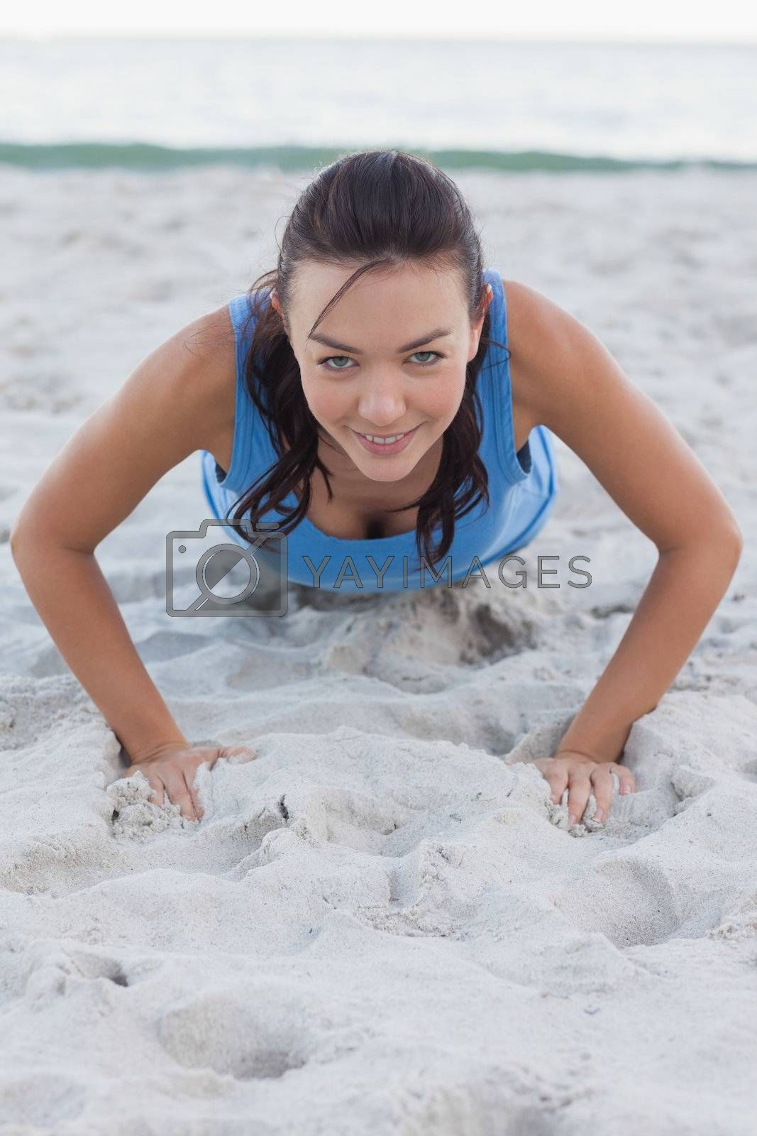 Woman exercising on the beach by Wavebreakmedia