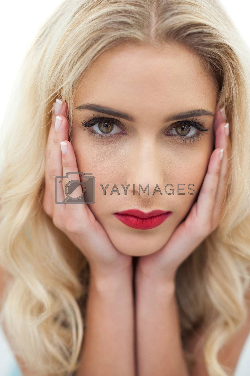 Close up of a stern blonde model looking at camera by Wavebreakmedia