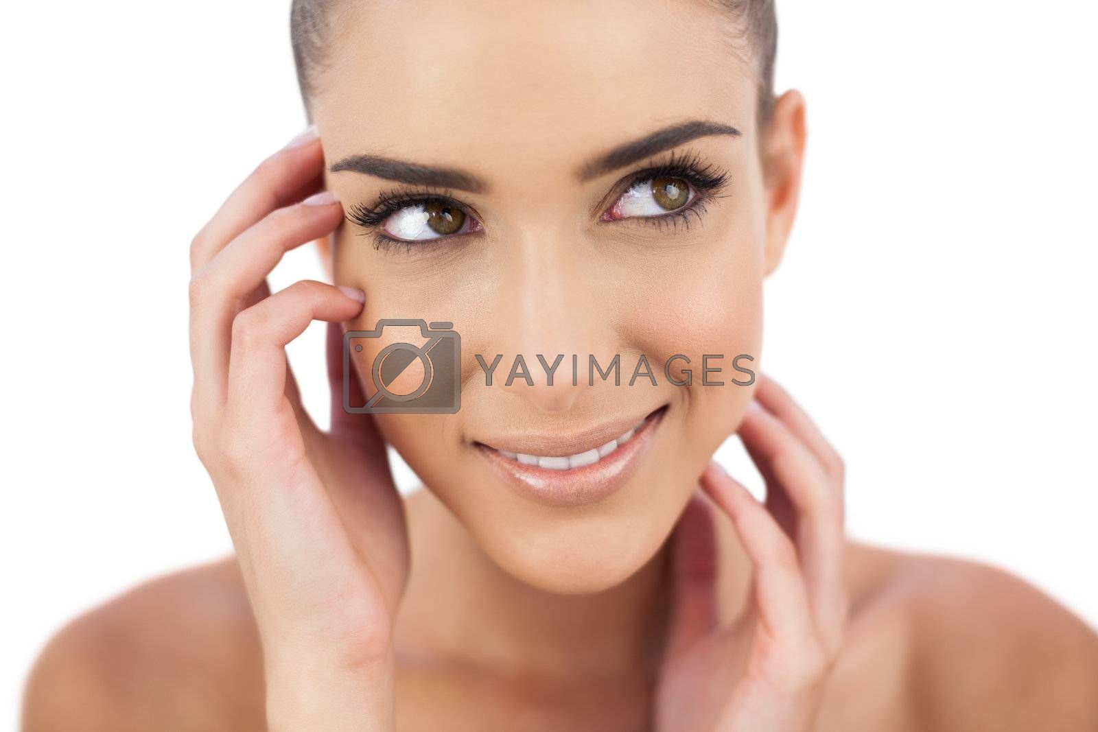 Close up of smiling woman looking away by Wavebreakmedia