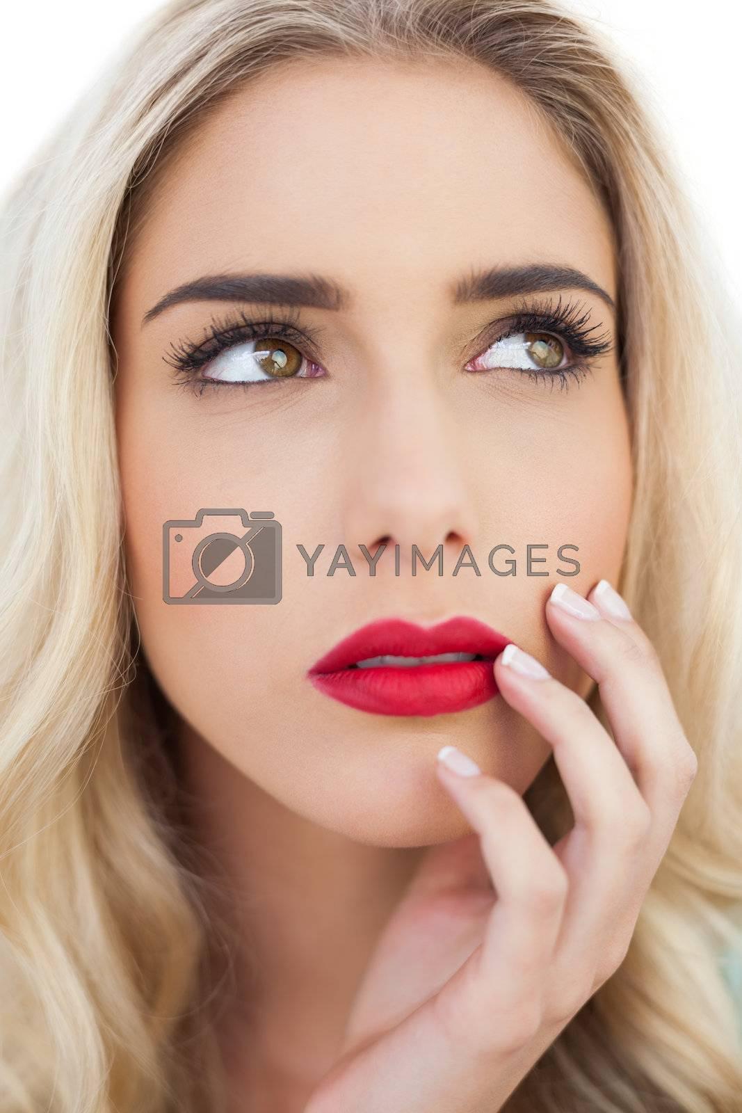 Portrait of a lovely blonde model looking away by Wavebreakmedia
