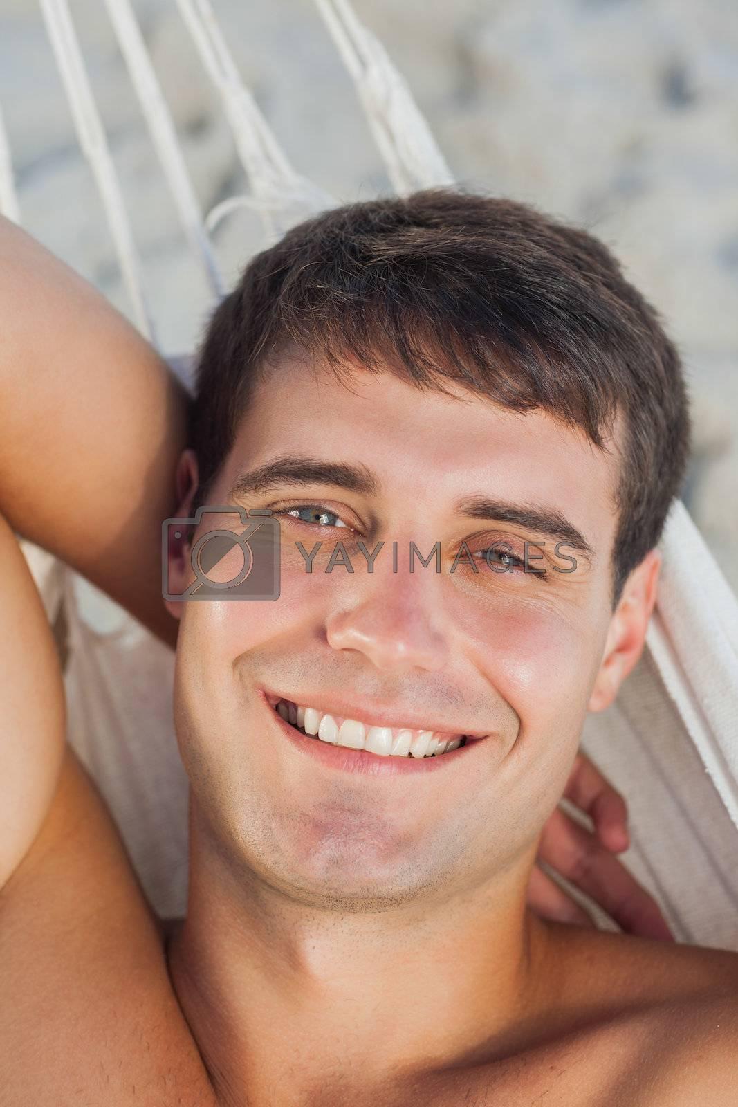 Attractive man lying in hammock by Wavebreakmedia