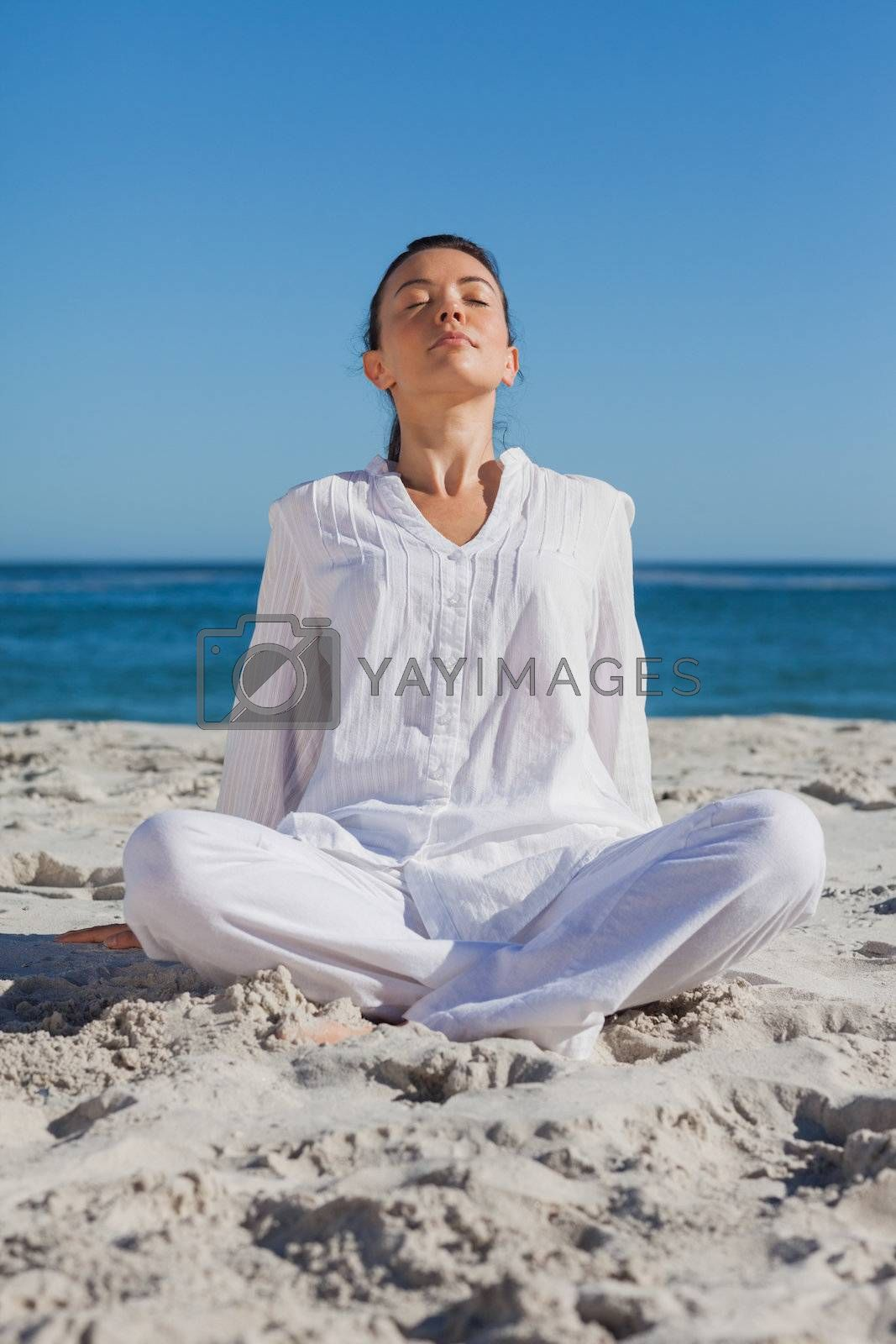 Woman relaxing at beach by Wavebreakmedia