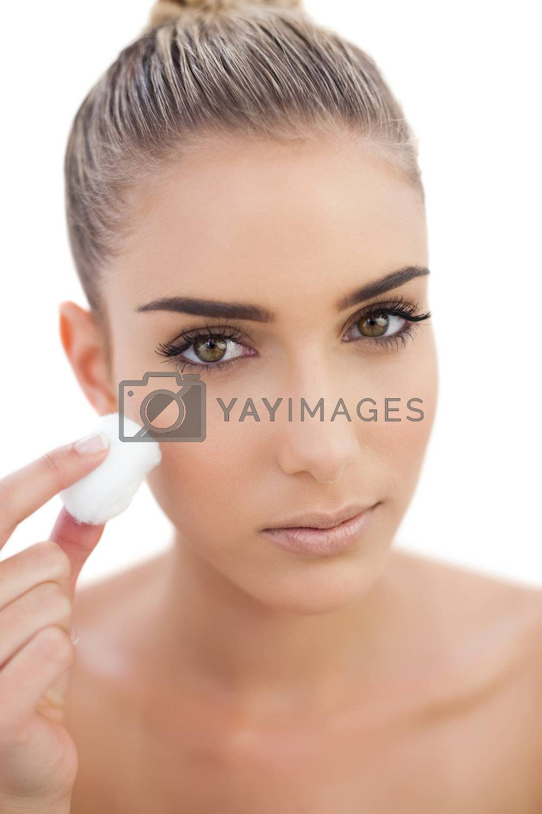 Serious woman rubbing her face by Wavebreakmedia
