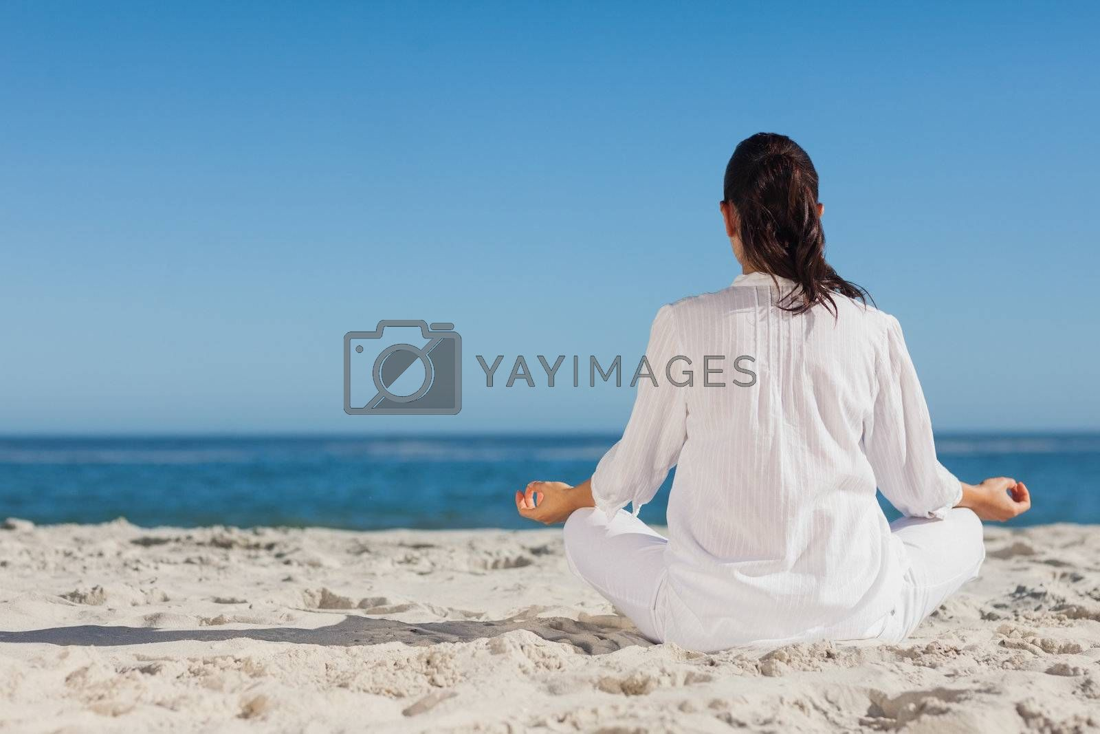 Woman doing yoga sitting back to camera by Wavebreakmedia