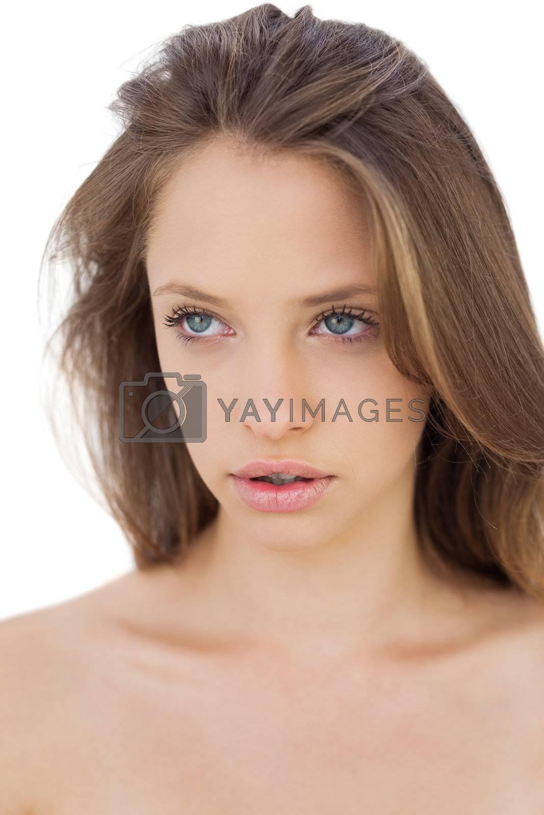 Serious brunette model looking away by Wavebreakmedia