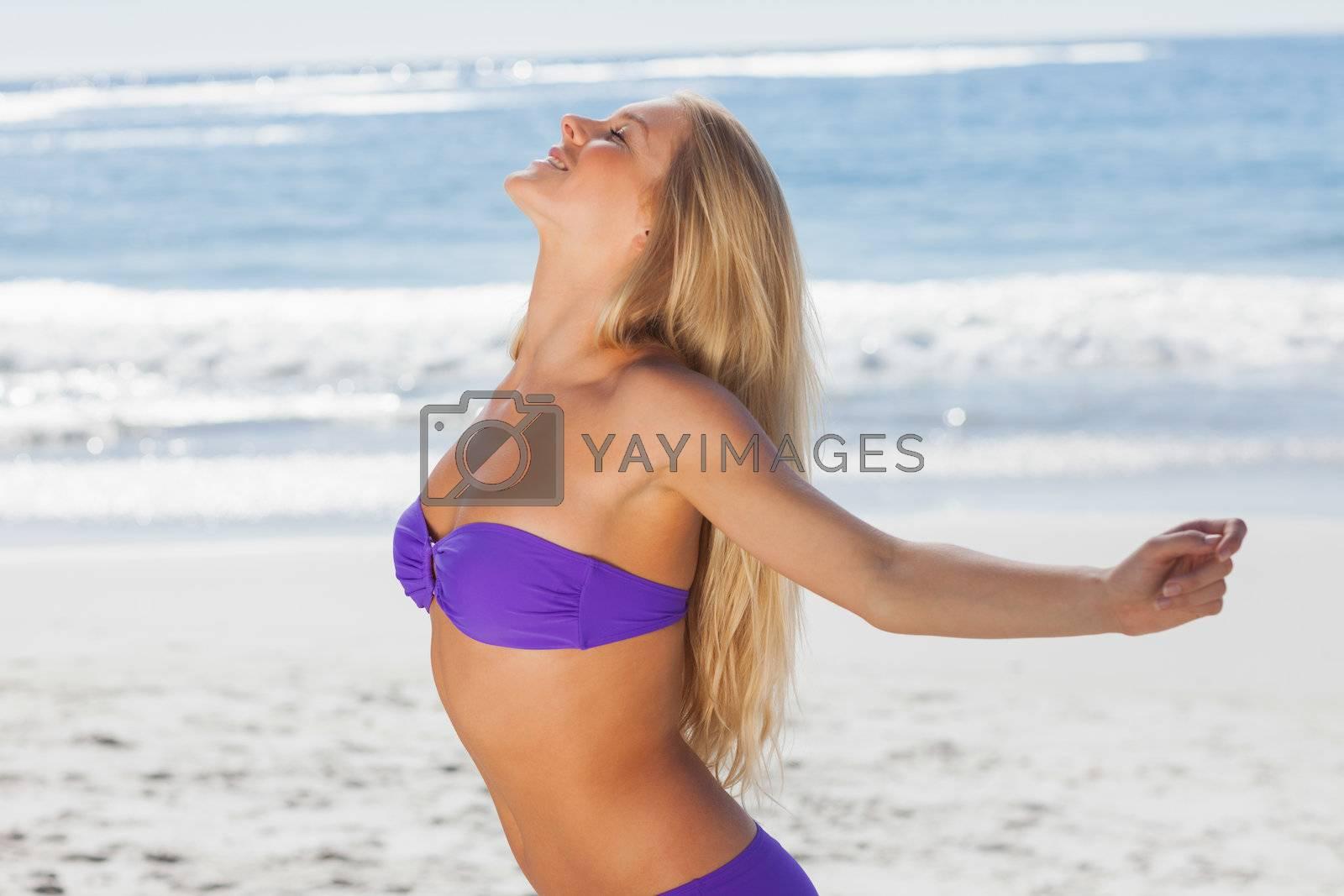 Blonde woman enjoying the sun by Wavebreakmedia