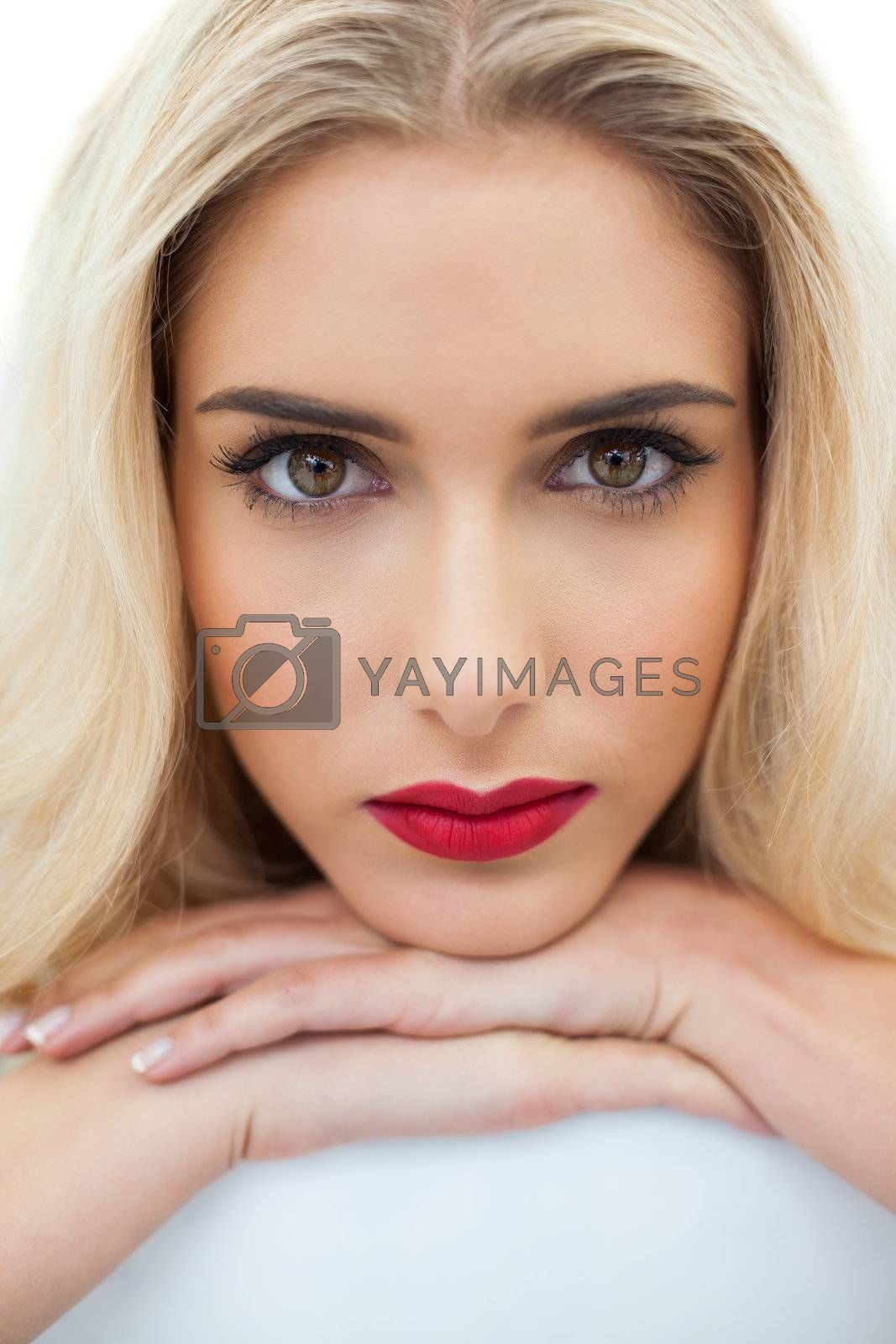 Close up of a serious blonde model looking at camera by Wavebreakmedia