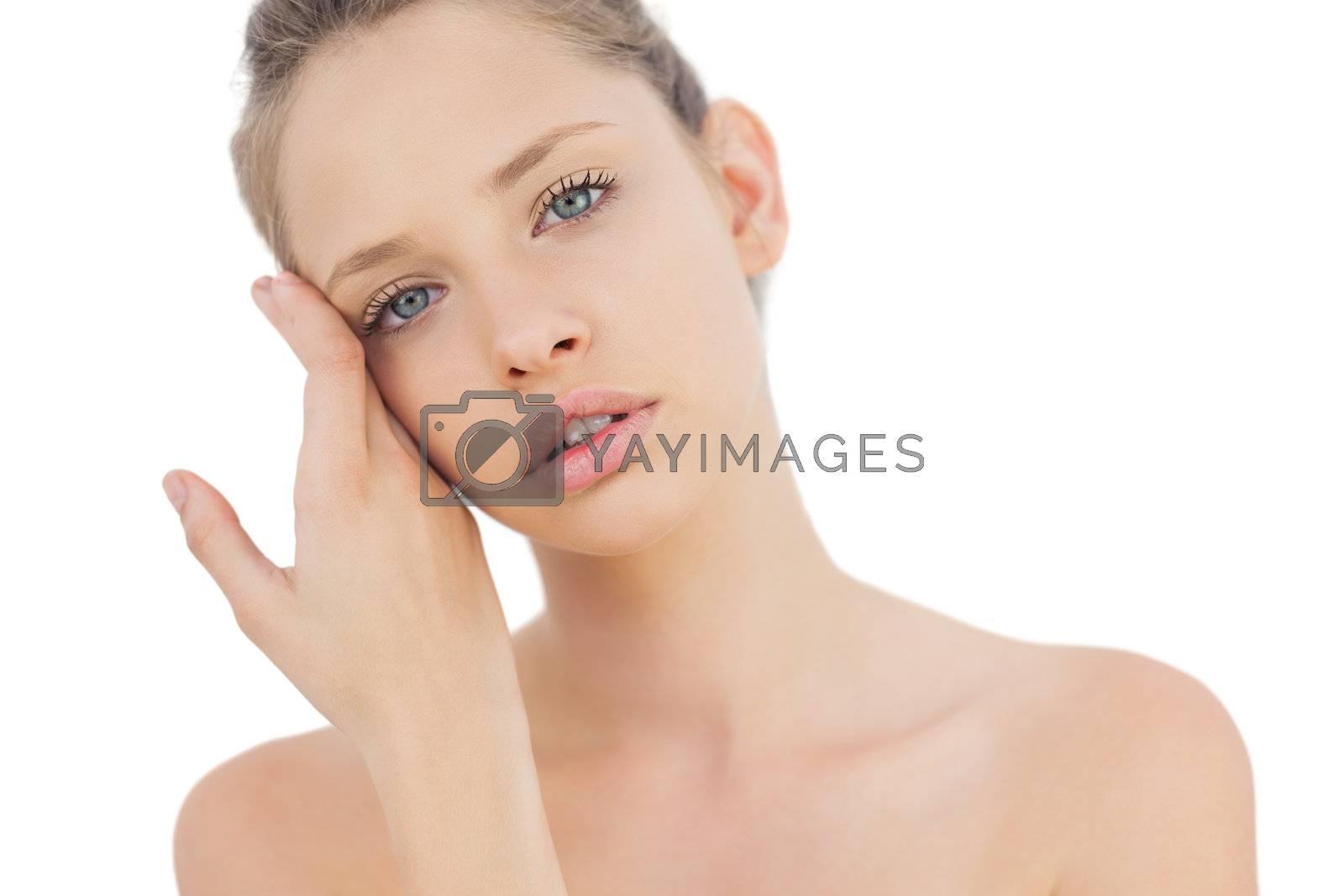 Natural brunette model posing looking at camera by Wavebreakmedia