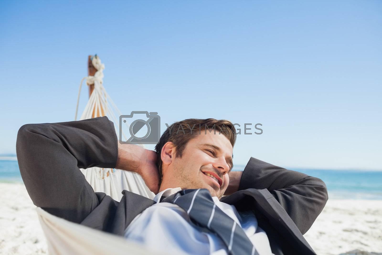 Businessman relaxing in hammock by Wavebreakmedia