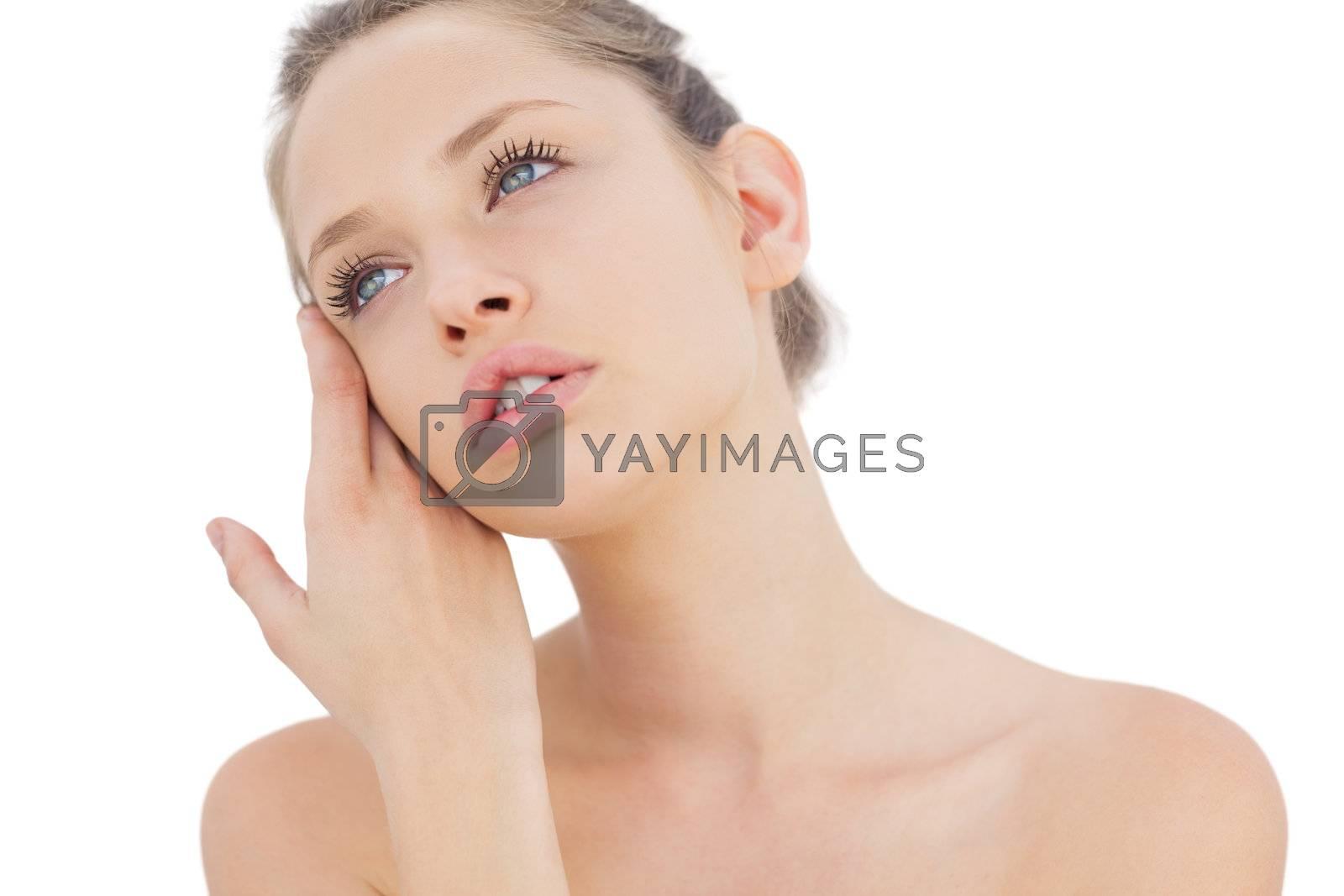 Stylish brunette model posing looking away by Wavebreakmedia