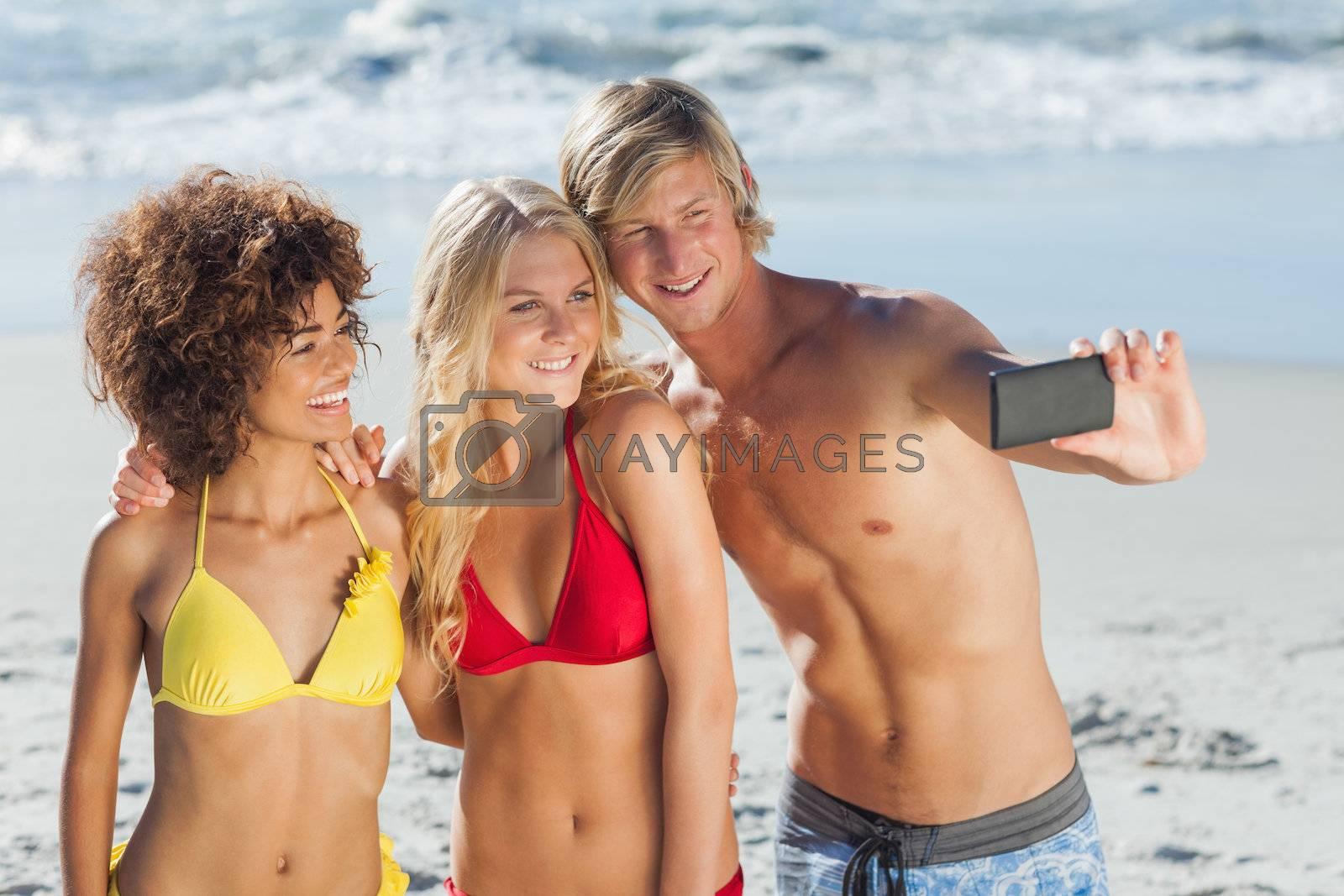 Three friends posing for a photo by Wavebreakmedia