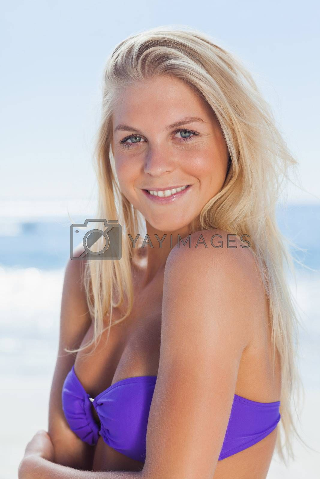 Attractive woman smiling at camera by Wavebreakmedia