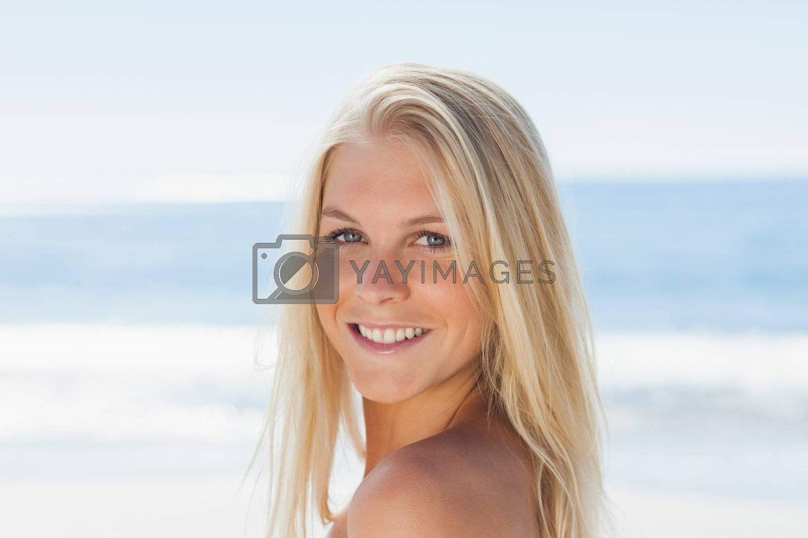 Close up view of blond woman smiling at camera by Wavebreakmedia