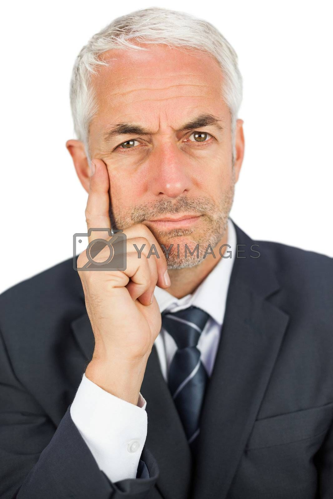 Pensive businessman looking at camera by Wavebreakmedia