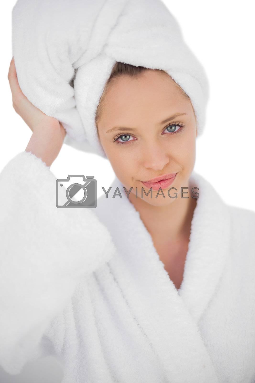 Content brunette in bathrobe looking  by Wavebreakmedia