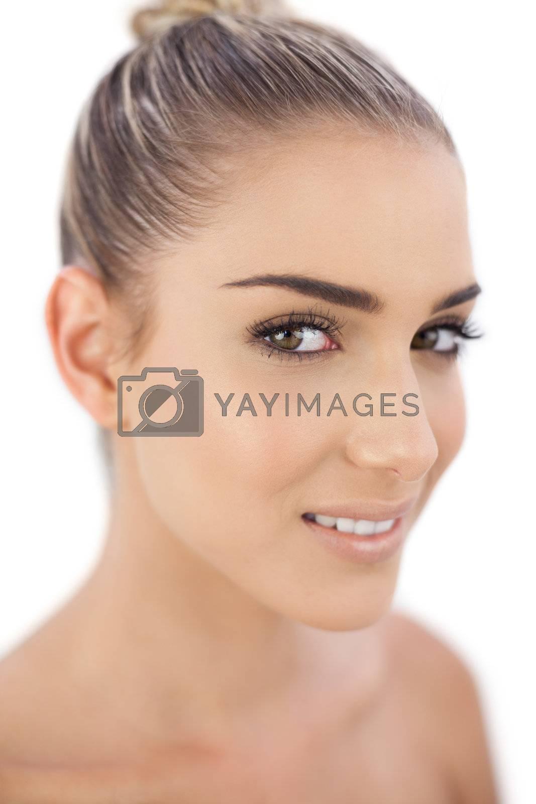 Smiling woman looking  by Wavebreakmedia