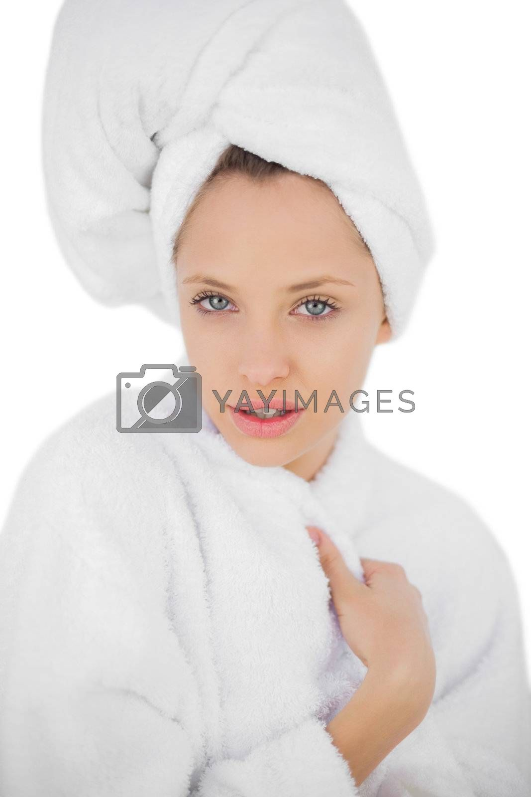 Pleased brunette in bathrobe looking at camera by Wavebreakmedia
