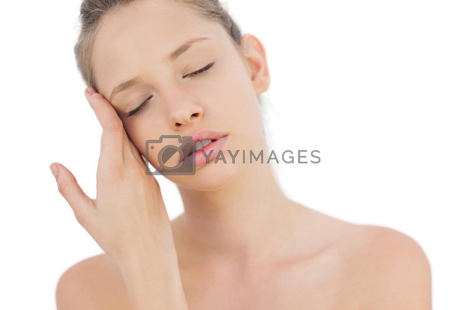 Tired brunette model posing closing her eyes by Wavebreakmedia