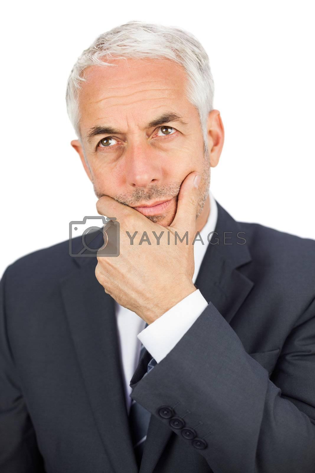Thoughtful businessman looking away by Wavebreakmedia