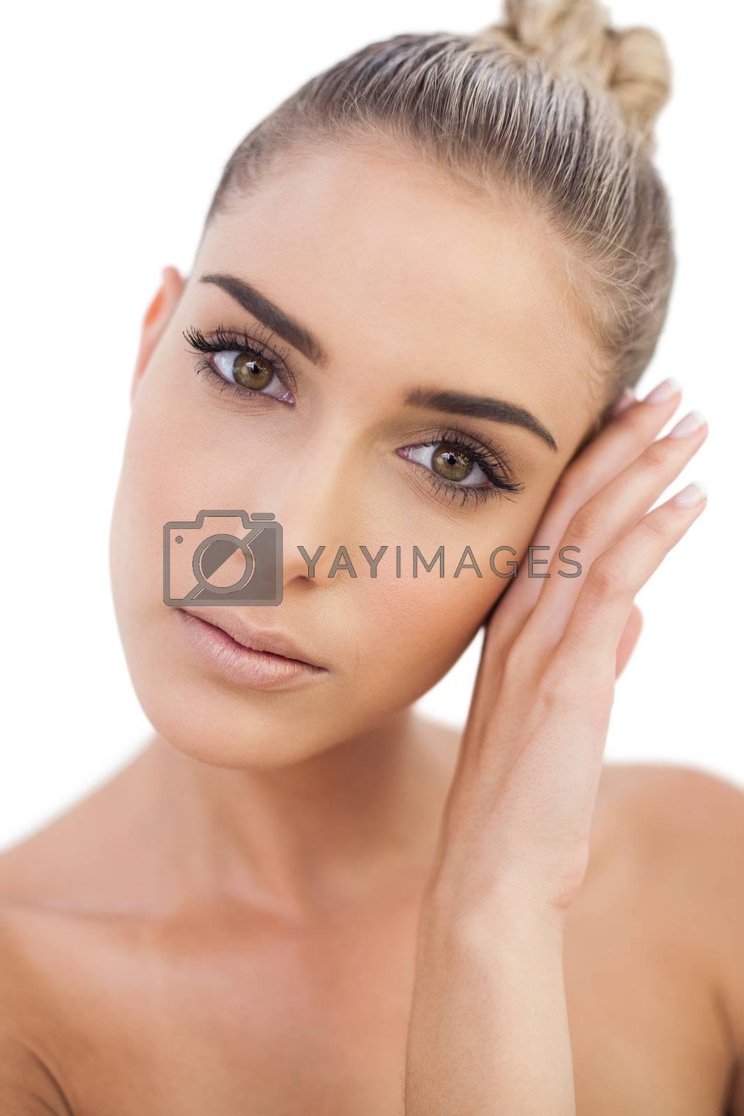 Natural woman looking at camera by Wavebreakmedia