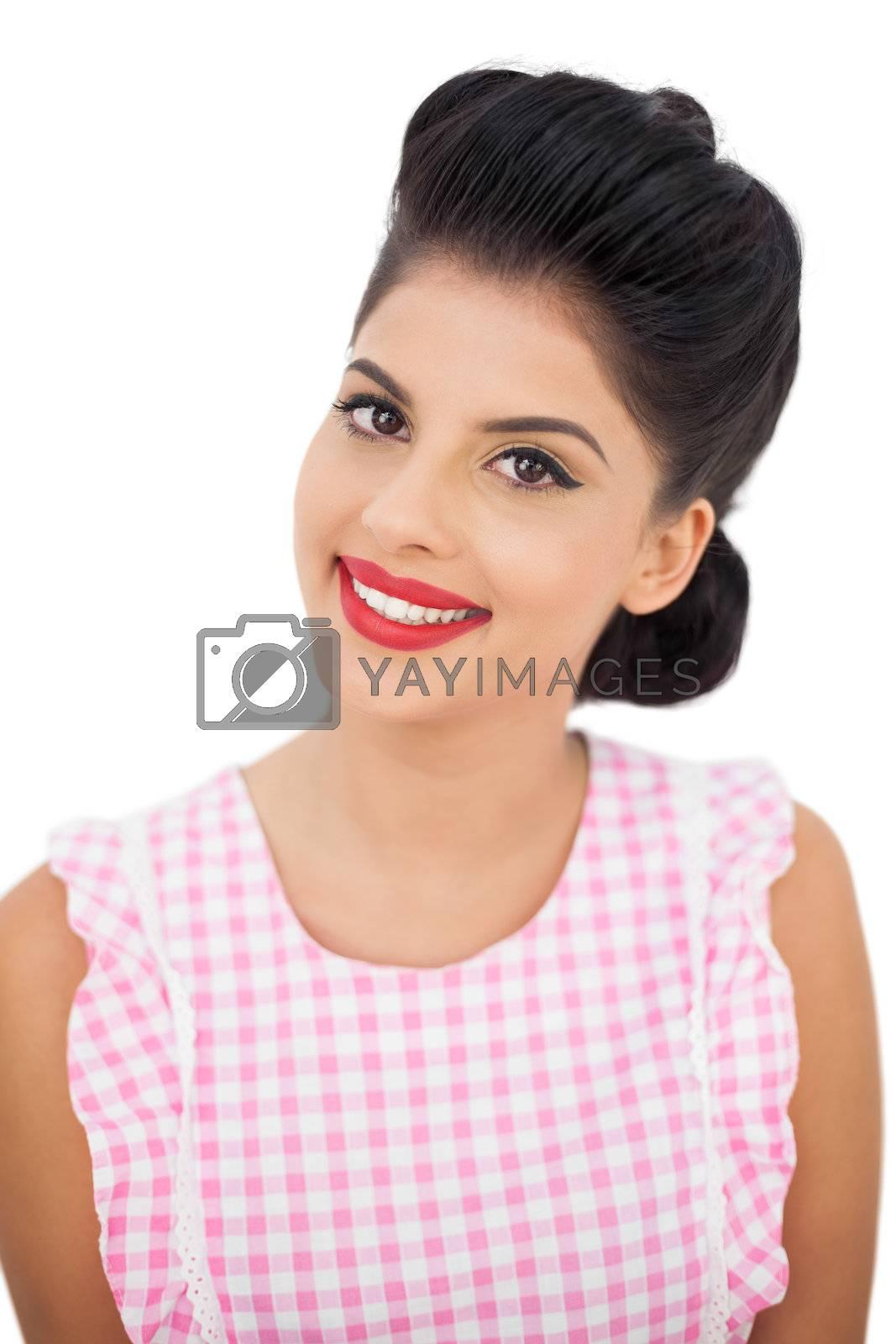 Smiling black hair model looking at camera by Wavebreakmedia
