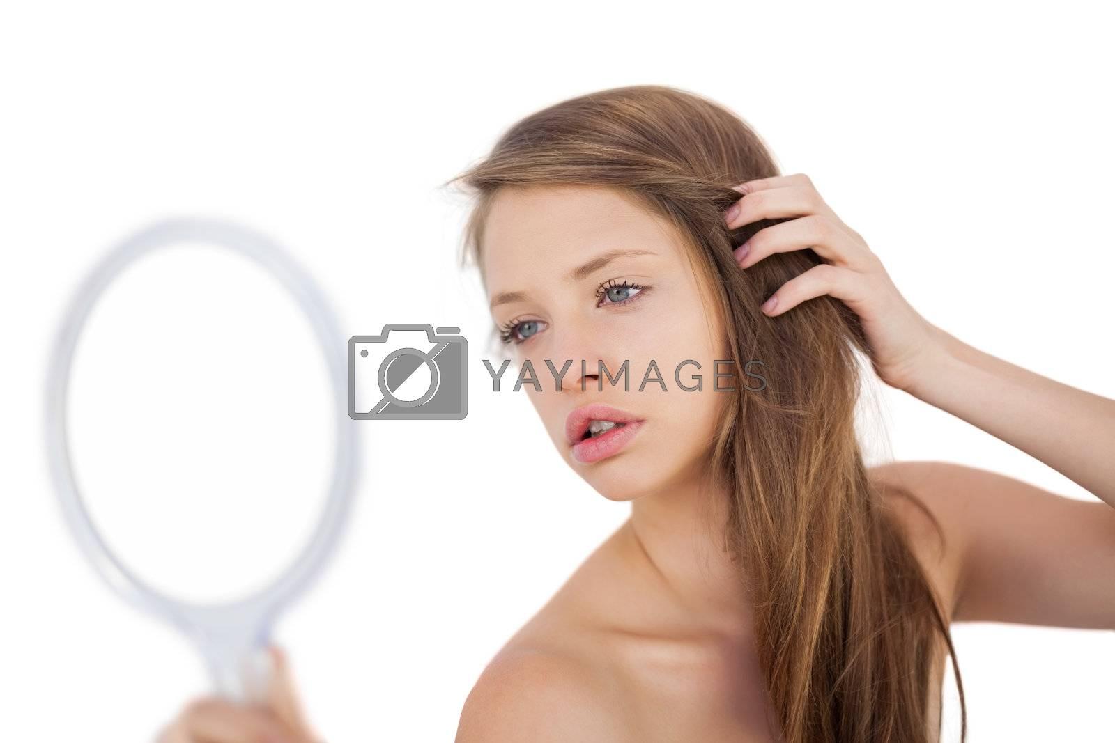 Calm brunette model posing looking herself in a mirror by Wavebreakmedia