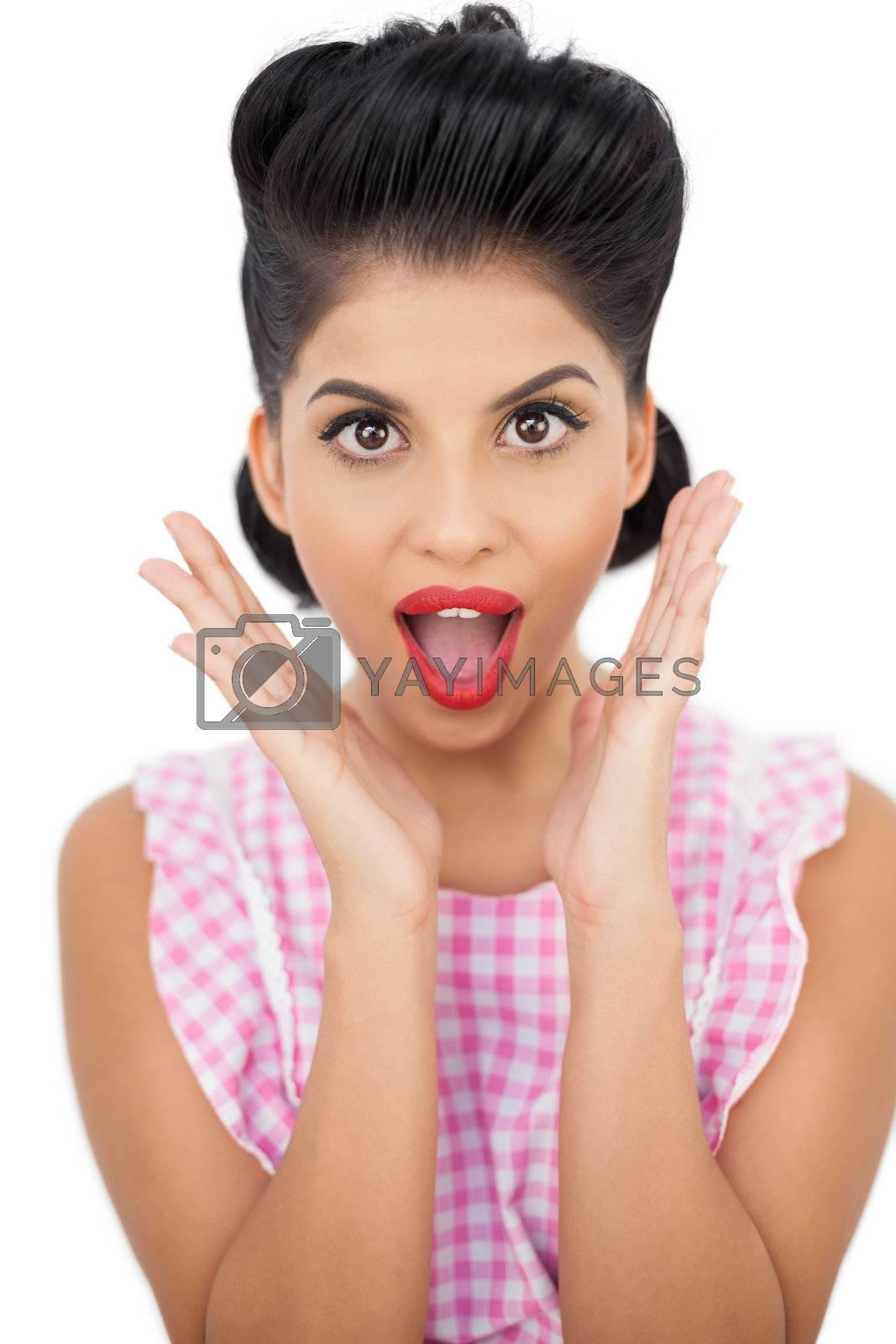 Shocked black hair model looking at camera by Wavebreakmedia