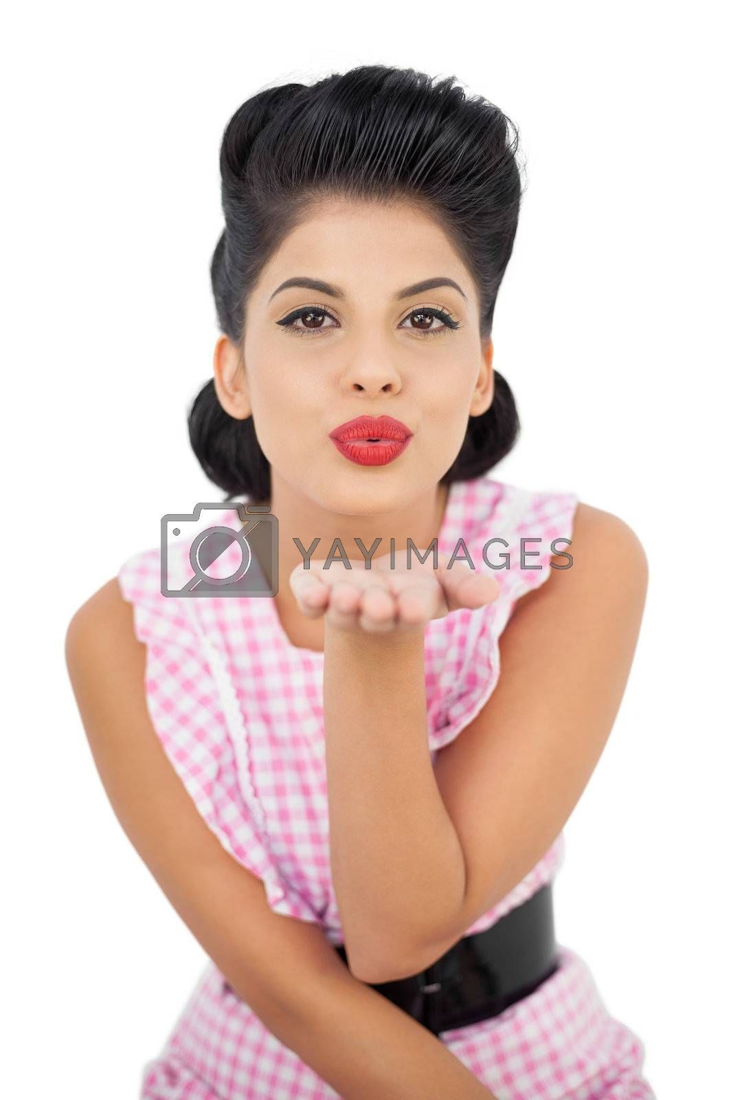 Pleased black hair model blowing a kiss to the camera by Wavebreakmedia