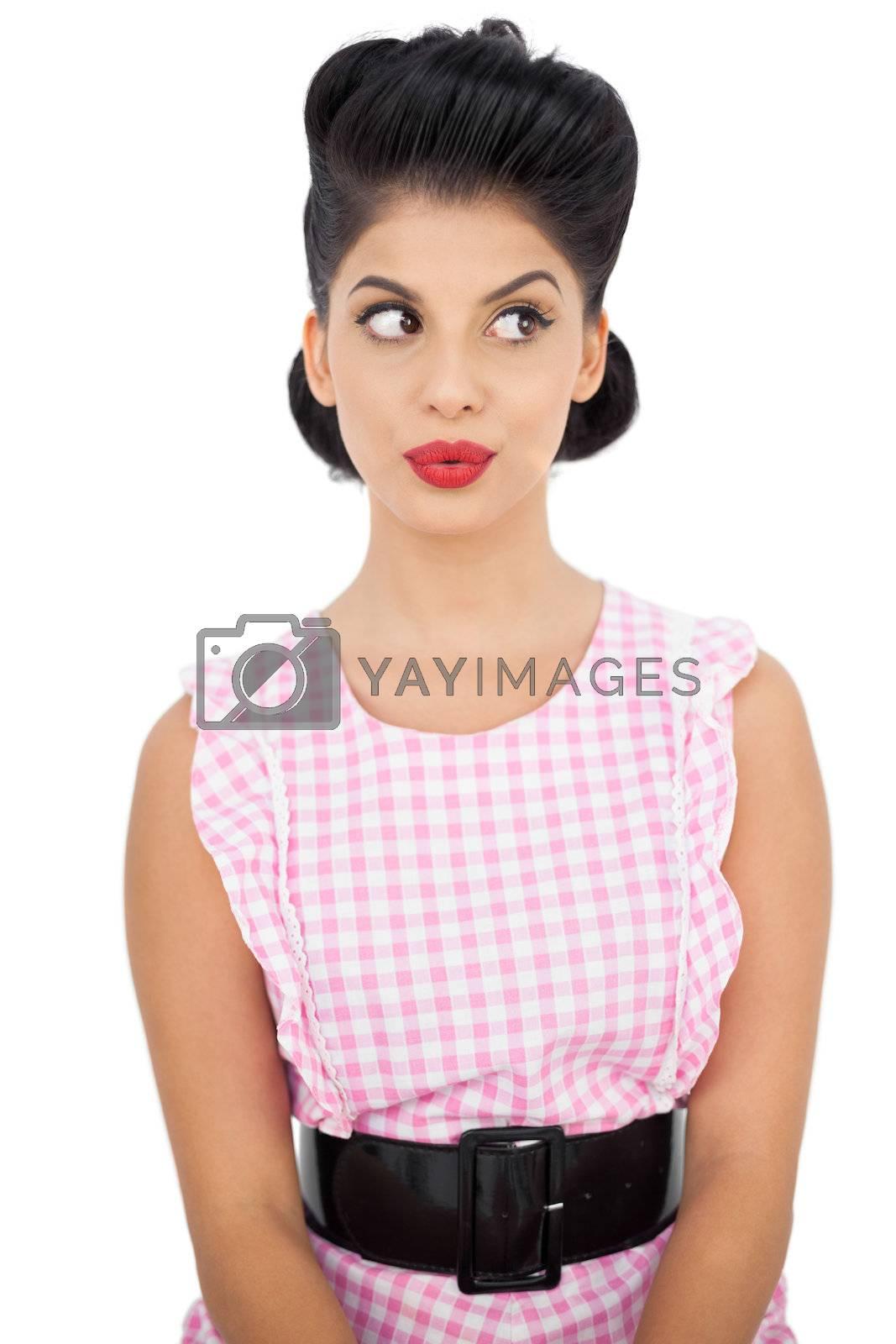 Serious black hair model looking away by Wavebreakmedia
