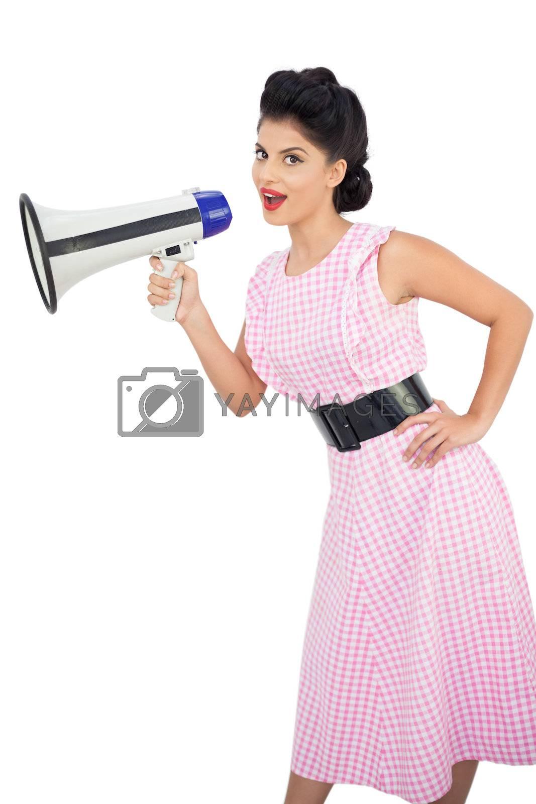 Smiling black hair model holding a megaphone by Wavebreakmedia