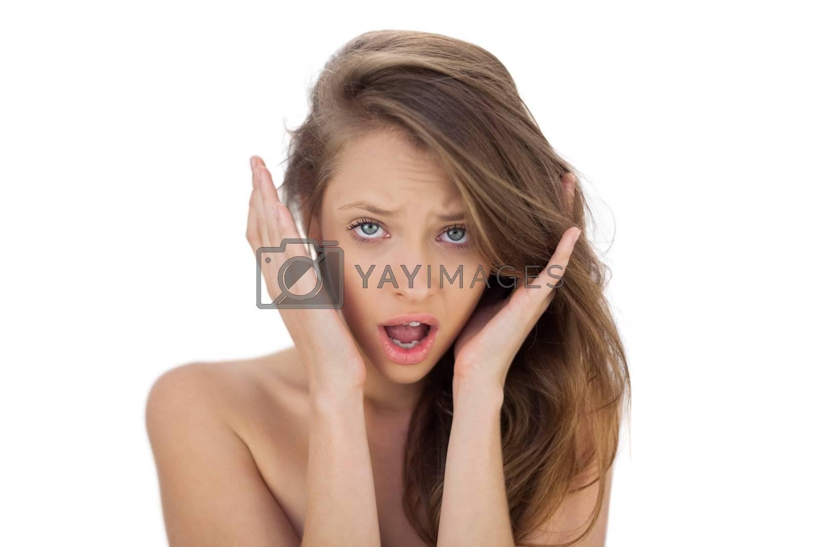 Irritated brunette model screaming looking  by Wavebreakmedia