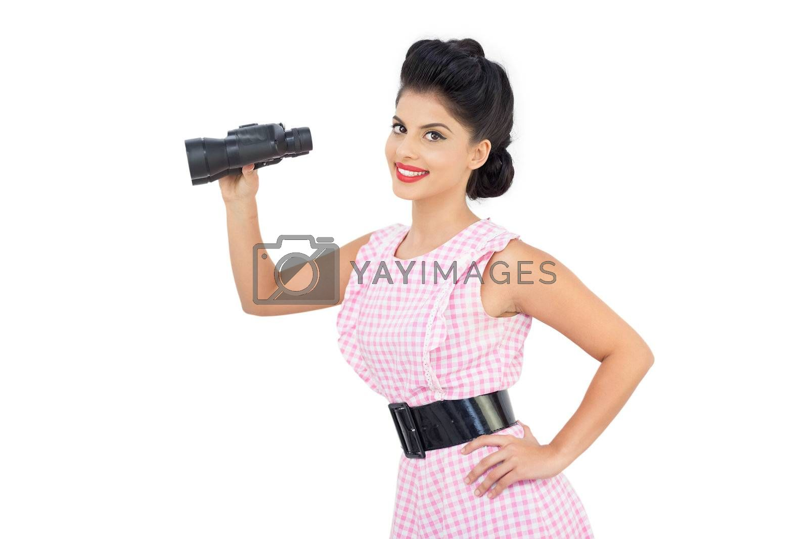 Smiling black hair model holding binoculars by Wavebreakmedia